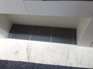 A custom made natural anodised aluminium return air grille